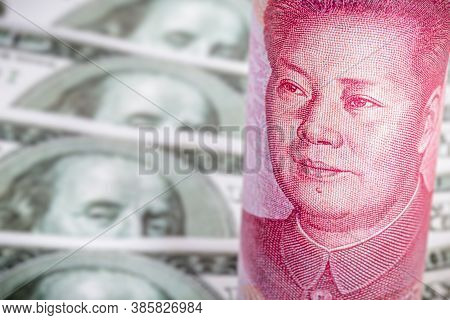 Banknotes Of 100 American Dollars And 100 Chinese Yuan Renminbi, Trade Tension Between China And The