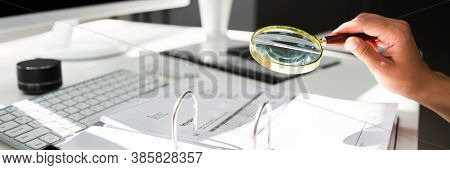 Fraud Investigation Using Magnifying Glass. Business Tax Audit