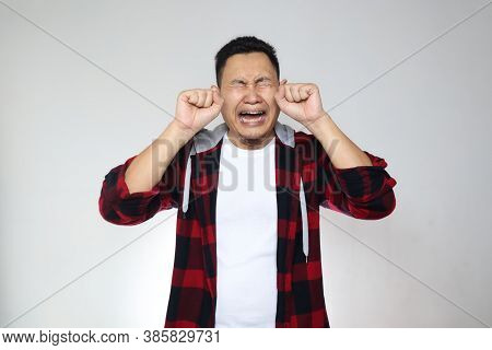 Funny Asian Man Crying Hard, Sad Depression Frustration Hopeless Expression, Against White Backgroun