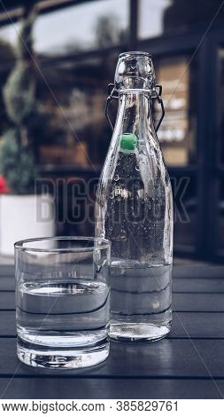 Mineral Water In A Glass On The Table,a Glass Bottle With Ordinary Natural Water.natural Water In A