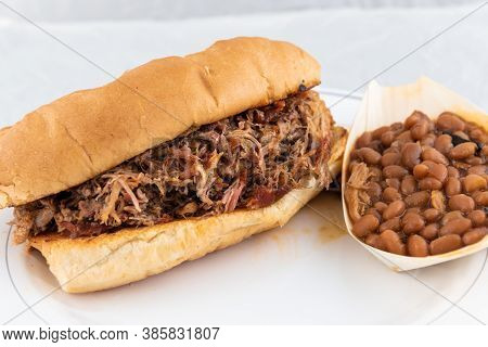 Bbq Meal Of Pulled Pork, Baked Beans, And Butter Toasted Bread Will Taste As Delicious As It Looks.