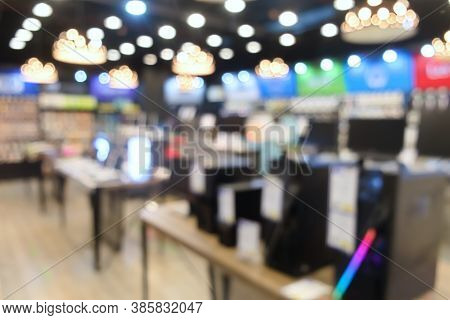 Blurred Image Background Of Interior Shop Store With Computer  Laptop And Accessory Device Products