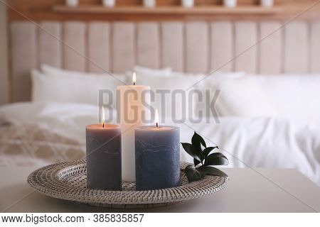 Tray With Burning Candles And Leaves On White Table Indoors. Space For Text
