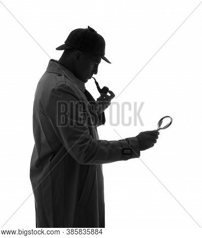 Old Fashioned Detective With Smoking Pipe And Magnifying Glass On White Background