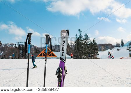 Hokkaido, Japan - December 2019 : Pair Of Ski And Snowboard Equipment Ready To Use With Background O