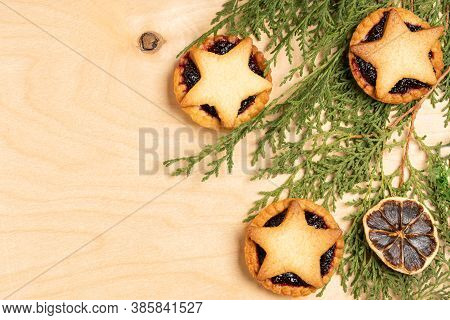 Christmas Homemade Mince Pies With Christmas Decorations On Wooden Background
