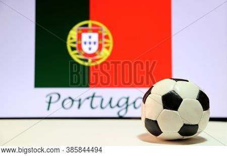 Small Football On The White Floor And Portuguese Nation Flag With The Text Of Portugal Background. T