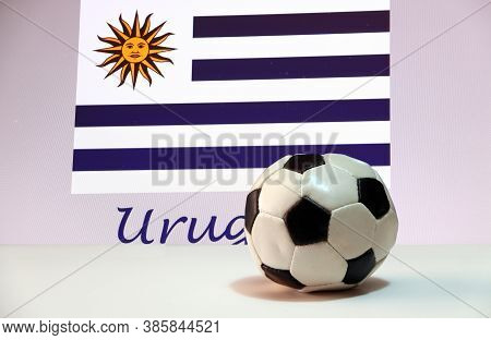 Small Football On The White Floor And Uruguayan Nation Flag With The Text Of Uruguay Background. The
