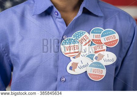 Close Up Of Multiple I Voted Stickers On Blue Shirt - Concept Of Us Election Voter Fraud By Placing
