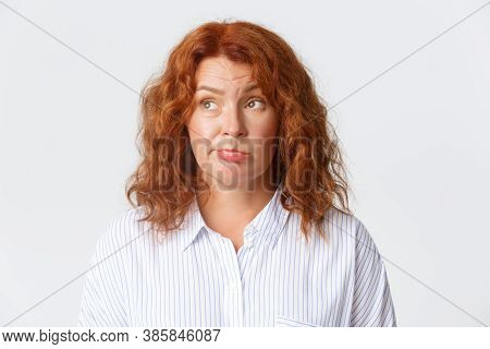 People, Emotions And Lifestyle Concept. Close-up Of Indecisive, Hesitant Middle-aged Redhead Woman P