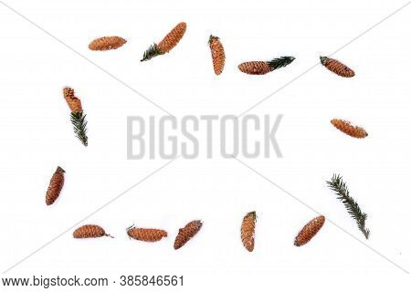 Frame Of Fir Cones On White Snow. Christmas Framework With Snow And Cones, Isolated On White Backgro