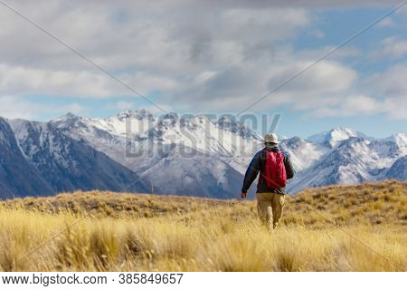 Hiker in beautiful mountains near Mount Cook, New Zealand, South island