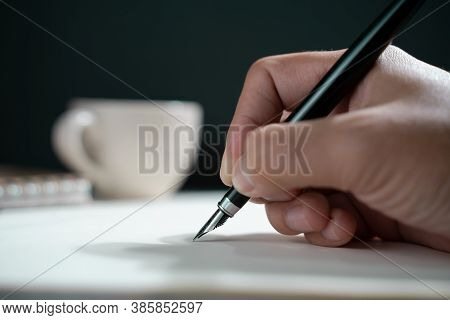 Person Writing On A Notebook, Close Up