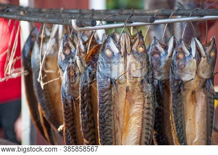 Dry Smoked Spiced Mackerel Fish In A Fish Market, Ready To Eat