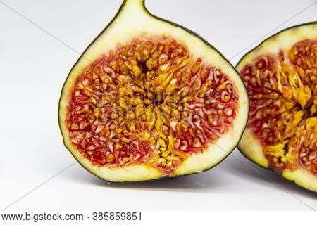 Two Halves Of Figs Isolated On A White Background. View Of Ripe Purple Violet Figs. The Fig From Ins