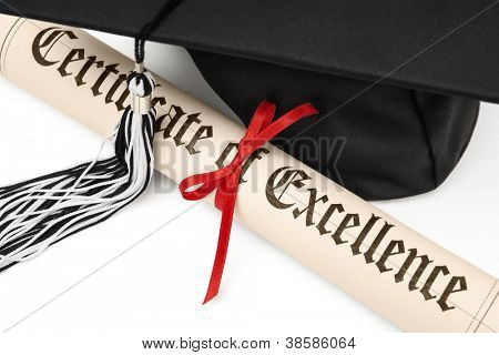 Diploma and black graduation cap