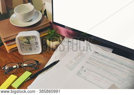 Home Office Desk Concept. Laptop, And Calculator For Accountant Or Bookkeeper Plan Annual Budget Rep