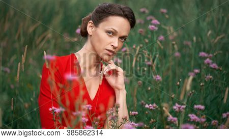Pretty Young Woman In A Red Dress Outdoors Portrait