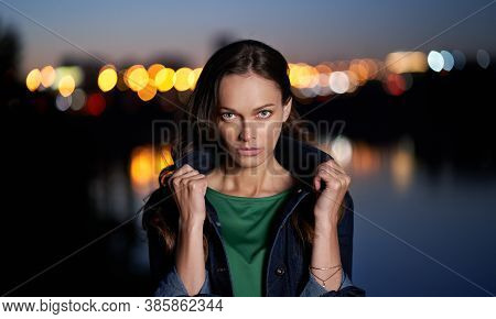 Portrait Of A Pretty Woman. Night City Lights On Background