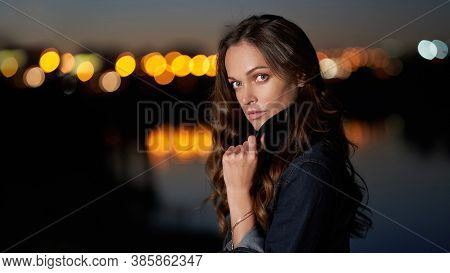 Beautiful Woman In The Night City. Outdoors Portrait With Evening Lights