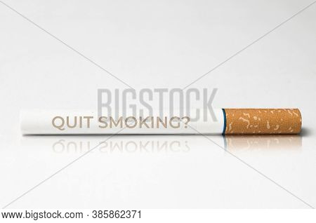 Quit Smoking Concept: Close Up Of A Cigarette With The Message Quit Smoking Printed On It
