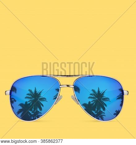Sunglasses With Palms Isolated On Yellow Background