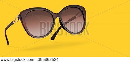 Retro Female Sunglasses Isolated On Yellow Background