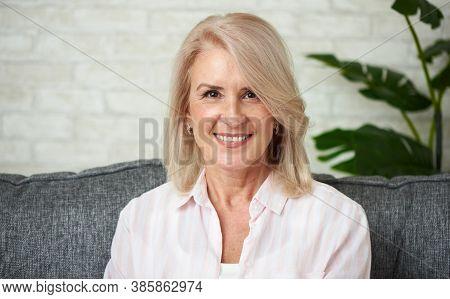 Portrait Of A Senior Woman. Mature Smiling Lady Feeling Happy