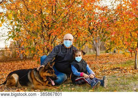 Grandfather And Granddaughter Wearing Face Mask During Coronavirus Outbreak. Virus Spread Flu Preven