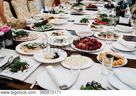 Served Table With Food. Plates With Dishes On The Table. The Beginning Of The Holiday. Festive Table