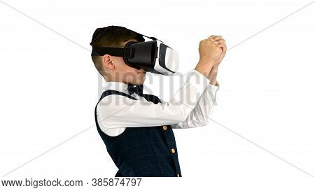 Excited Boy In Formal Wear Playing The Sword Game In Virtual Rea