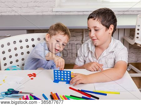 Children Playing Board Game In Their Room. Happy Sibling Are Having A Lot Of Fun Together, Playing B