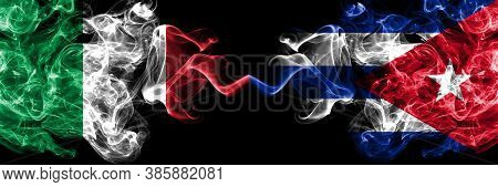 Italy Vs Cuba, Cuban Smoky Mystic Flags Placed Side By Side. Thick Colored Silky Abstract Smoke Flag