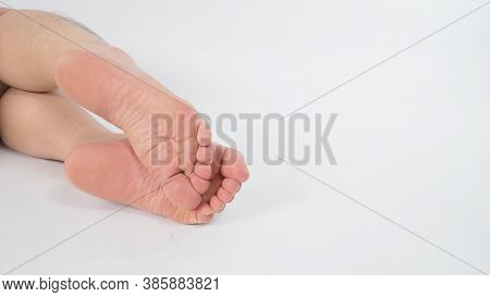 Close Up Of Man Sole Of Foot On White Background