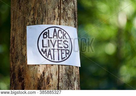 Kiev, Ukraine - July 31 2020: Black Lives Matter Inscription In Circle On Tree. Stop Racism Concept.