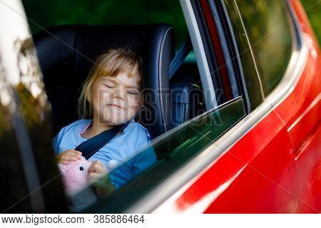 Sad Upset Little Kid Girl Sitting In Car In Traffic Jam During Going For Summer Vacation With His Pa