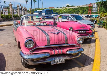 Havana, Cuba-october 07, 2016. Old Style, Classic, Colourful American Cars, Used As Taxi, Parked Nex