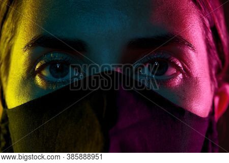 health, safety and pandemic concept - close up of young woman wearing black reusable protective mask