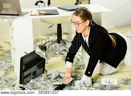 Woman Counting Money. Financial Success. Tax Service. Business Investment. Office Is Littered With M