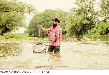 Fishing Is Astonishing Accessible Recreational Outdoor Sport. Bearded Fisher Catching Trout Fish Wit
