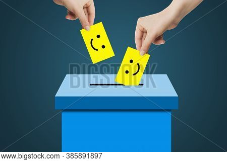 Customer Experience And Feedback Concept : Hand Holding And Putting Smile Emotional Face Icon Symbol