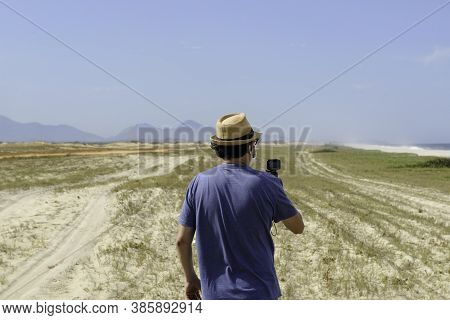 The New Normal - Middle-aged Man Takes A Picture Of The Beach In A Place Without Agglomeration, Wear