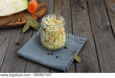 Homemade Sauerkraut In A Glass Jar On A Rustic Background. Fermented Product
