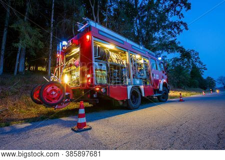 Bavaria / Germany - September 16, 2020: German Firetruck Stands On A Street Near A Forest