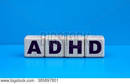 Concept Word Adhd (attention Deficit Hyperactivity Disorder) On Cubes On A Blue Background. Medical