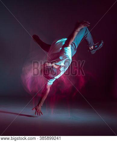 Cool Young Guy Breakdancer Dancing In Neon Light. Dance School Poster. Long Exposure Shot