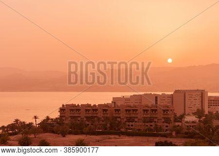 Coastal Cityscape Of Aqaba City At Sunset, Bird Eye View