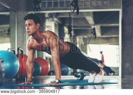Trainer Man Exercise For  Functional Plank Training And Cross Fit The Gym Workout For Healthy Care A