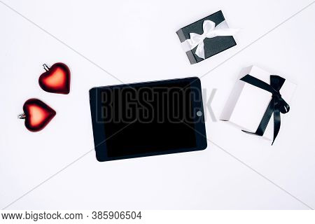 Black And White Gift Boxes, Heart Shaped Christmass Tree Baubles And Electonic Tablet On White Backg