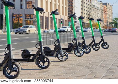 Eco Transportation Concept. Scooter Rental In The City. Environment Conservation. Eco Friendly Trans